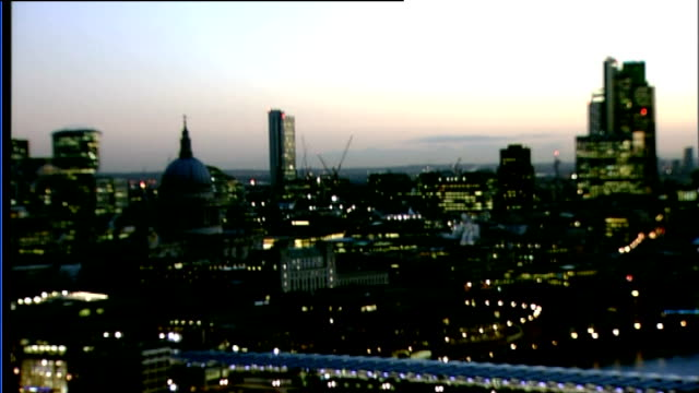 scientists predict effects of solar superstorms; england: london: ext night / day speeded up time lapse rooftops of london from night to day - time of day stock videos & royalty-free footage