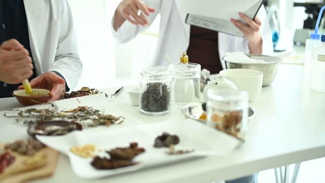 scientists researching chinese herbal medicine. - herbal medicine stock videos & royalty-free footage