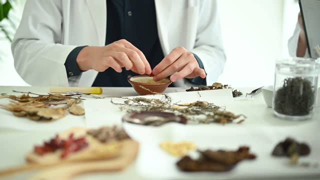 scientists researching chinese herbal medicine. - nutritional supplement stock videos & royalty-free footage