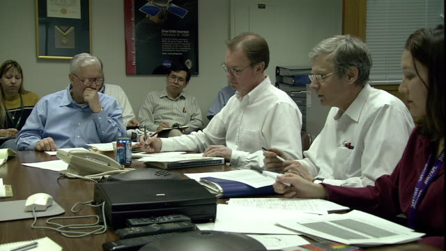 scientists sit around a table during a meeting. - laurel maryland stock videos & royalty-free footage