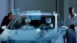 Scientists testing a car driving robot