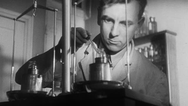 1941 montage scientists treating diphtheria anti-toxins to make toxoid to prevent the disease / united kingdom - diphtherie stock-videos und b-roll-filmmaterial