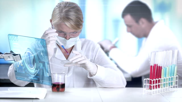 scientists working in a chemical lab. - replication bubble stock videos and b-roll footage