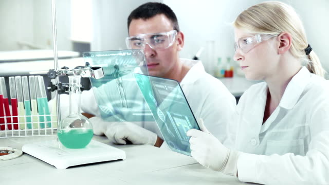 scientists working in a chemical laboratory. - replication bubble stock videos and b-roll footage