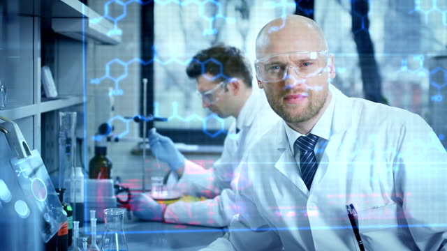 scientists working in a research laboratory - lab coat stock videos & royalty-free footage