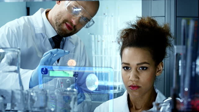 scientists working in a research laboratory - medical equipment stock videos & royalty-free footage