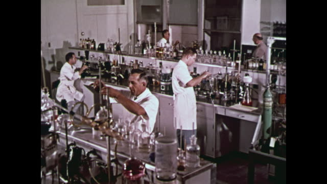 1959 scientists working in ford research & development laboratories - オシロスコープ点の映像素材/bロール