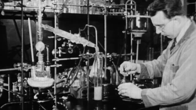 vidéos et rushes de ms scientists working in lab and performing experiments / united states - 1930