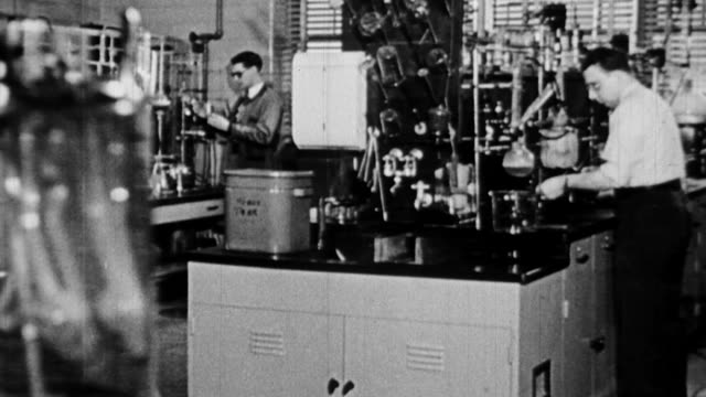 ws scientists working in lab and performing various experiments / united states - 化学者点の映像素材/bロール