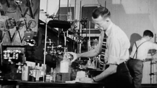 ws scientists working in  lab and performing various experiments / united states - black and white stock videos & royalty-free footage