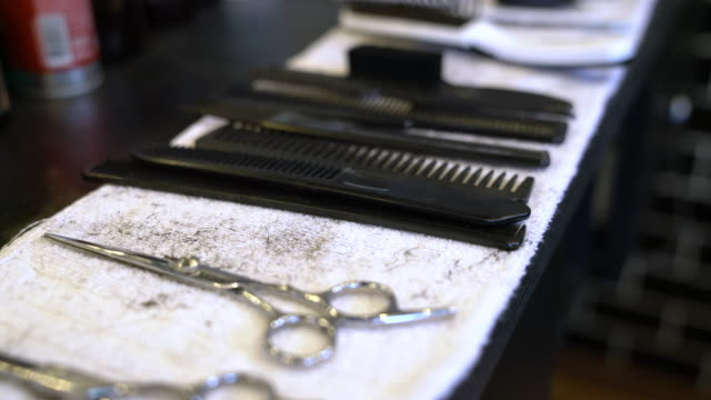 scissors and combs on napkin in barbershop - barber shop stock videos & royalty-free footage