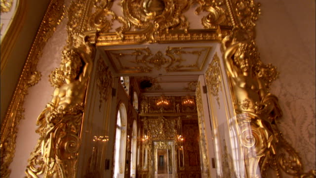 sconces glow on the golden walls of catherine palace. - russia stock videos & royalty-free footage