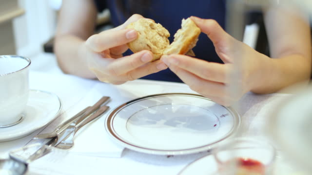scone with afternoon tea - english culture stock videos & royalty-free footage