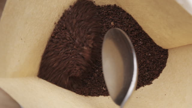 scooping coffee into pour over filter - handful stock videos & royalty-free footage