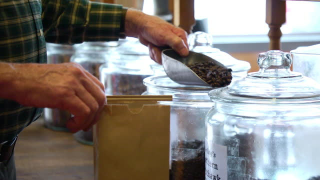 scooping measuring coffee beans into bag for sale - paper bag stock videos & royalty-free footage