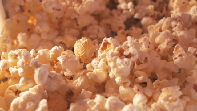 scooping popcorn - popcorn stock videos & royalty-free footage