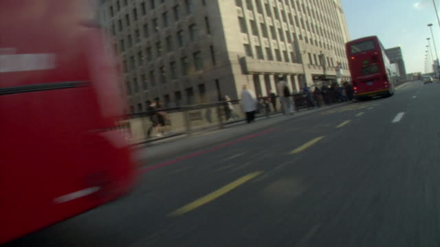 pov, canted, scooter driving on bridge, london, england - scooter stock videos & royalty-free footage