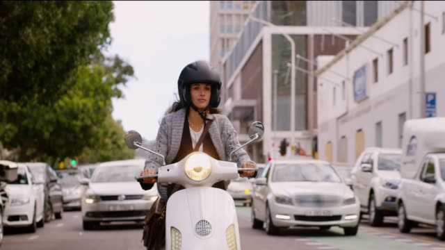 a scooter makes the perfect fashion accessory - motorino video stock e b–roll