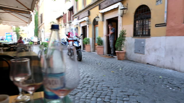 scooter on narrow street in rome - motorino video stock e b–roll