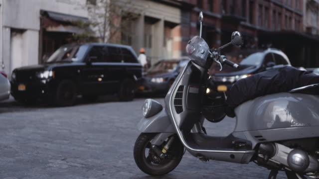 scooter parked on cobbled street. - stationary stock videos & royalty-free footage
