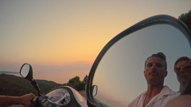 pov scooter riders in the mirror - scooter stock videos & royalty-free footage