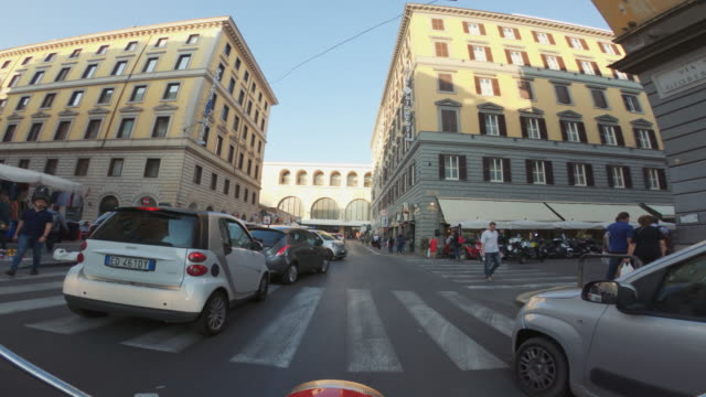 pov scooter riding in the chaotic traffic of rome - motor scooter stock videos & royalty-free footage
