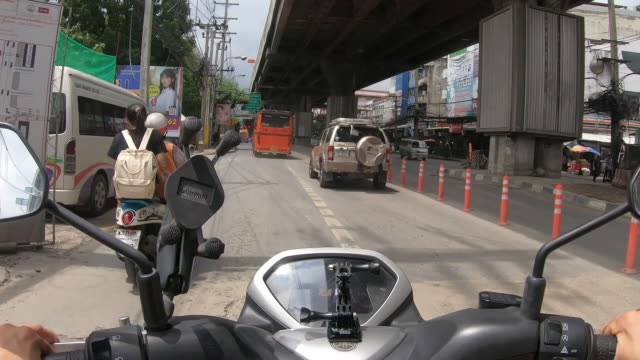 pov scooter : riding on bangkok street with a traffic jam. - motorbike stock videos & royalty-free footage