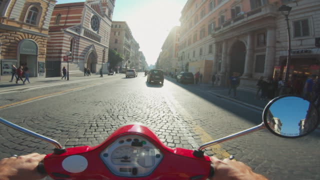 pov scooter riding: on the motorbike in the center of rome - motorino video stock e b–roll