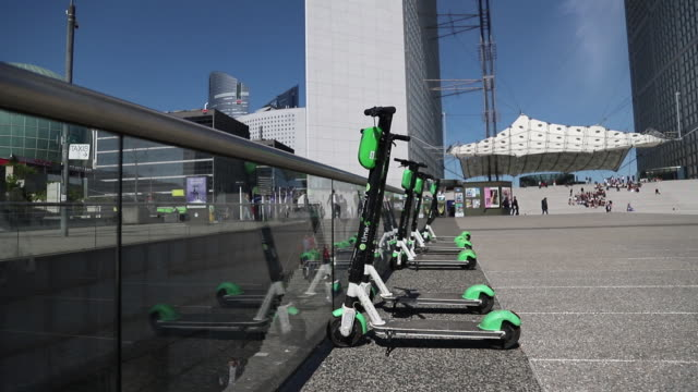 scooters and bikes in several city districts uber dott flash bird voi lime coup cityscoot in paris france on thursday may 16 2019 - push scooter stock videos & royalty-free footage