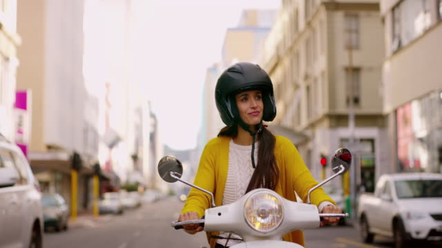 scooting around town is the easy way to drive - crash helmet stock videos & royalty-free footage