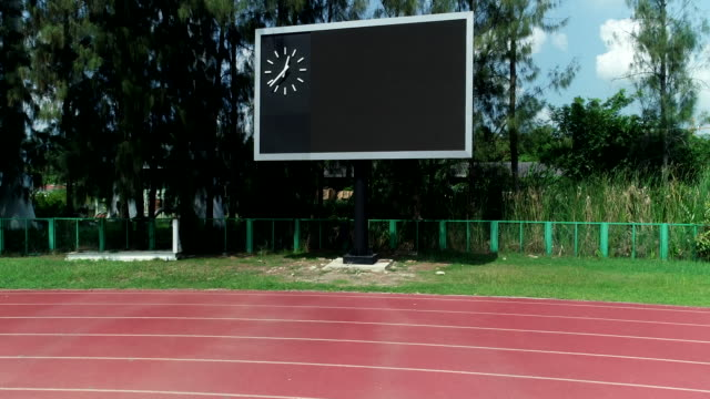 score board at the running track area, shot by drone. - scoreboard stock videos & royalty-free footage