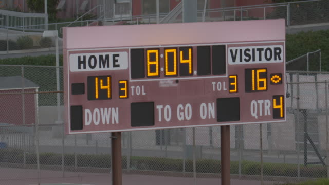 scoreboard at a night football game, friday night lights, american football. - slow motion - scoring stock videos & royalty-free footage