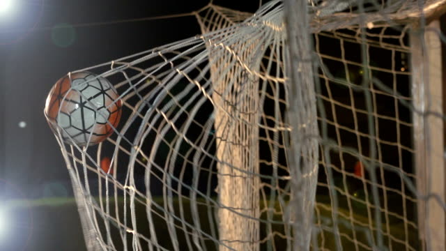 goal scored with soccer ball / football in net - super slow motion - net sports equipment stock videos and b-roll footage