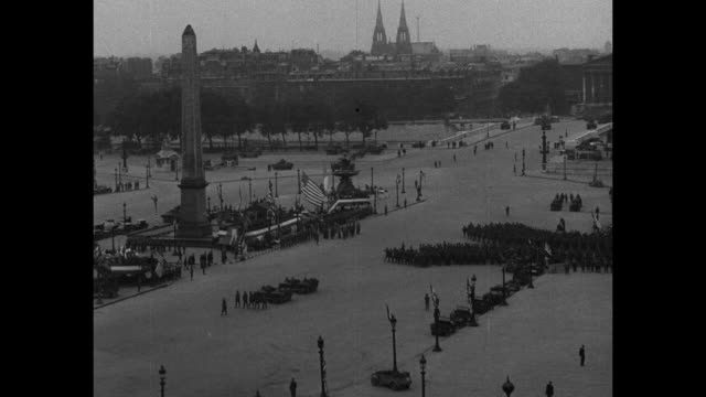 Scores of American soldiers march in right profile / hundreds of American soldiers march on Place de la Concorde with Luxor Obelisk and American...