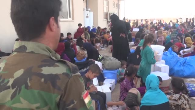 scores of civilians fled hawija after iraqi forces launched an assault on the northern town one of the last bastions in the country still held by the... - civilian stock videos & royalty-free footage