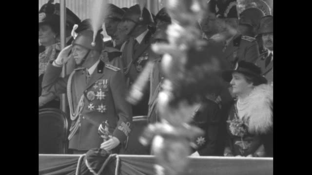 scores of italian soldiers march past reviewing stand during constitution day parade in rome / lr victor emmanuel iii princess maria francesca of... - maultier stock-videos und b-roll-filmmaterial