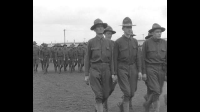 vídeos y material grabado en eventos de stock de scores of new wwi soldiers march in ordered rows at camp lewis / two shots of a line of soldiers being reviewed by five officers - 1917