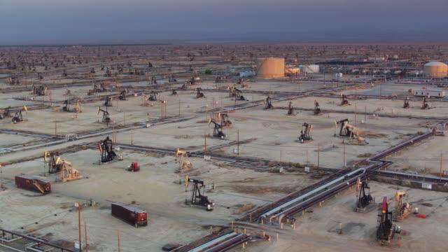 Scores of Nodding Donkey Oil Wells in South Belridge Oil Field - Drone Shot