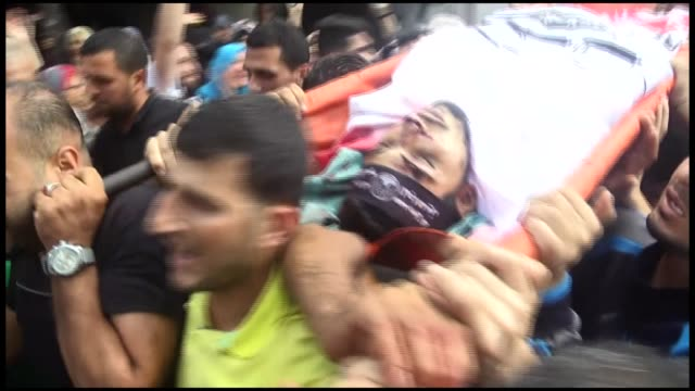 scores of palestinians on october 17 2018 paid farewell to a youth martyred by an israeli airstrike in the northern gaza strip naji alzaanin was... - historical palestine stock videos & royalty-free footage