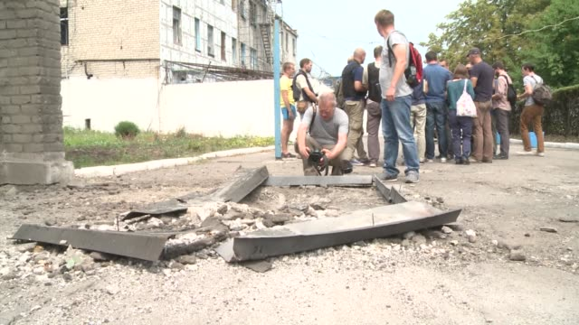 Scores of panicked inmates escaped when shells rained down on a high security prison in eastern Ukraine during heavy fighting between government...