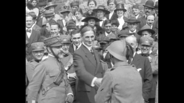 Scores of uniformed men marching through the North Lawn gate and past the East Wing / United States Secretary of the Treasury William Gibbs McAdoo...