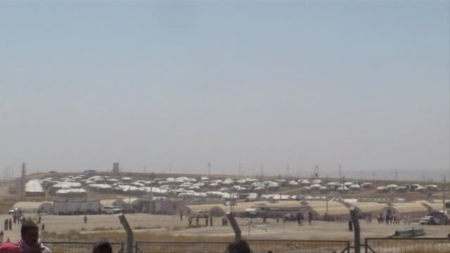 scores of young men and children held a protest demanding more aid wednesday at the bajid kandala camp that is hosting thousands of desperate iraqi... - ninawa stock videos & royalty-free footage