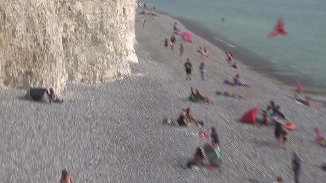 scores treated for chemical 'mist' in east sussex england east sussex ext people on clifftop tilt down people on beach adults and children climbing... - east sussex stock videos & royalty-free footage