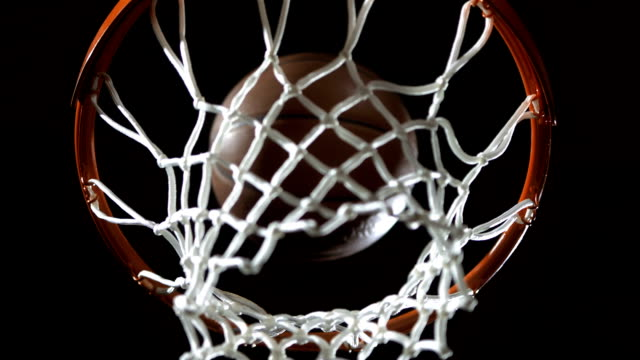 scoring a basket (super slow motion) - shooting baskets stock videos and b-roll footage