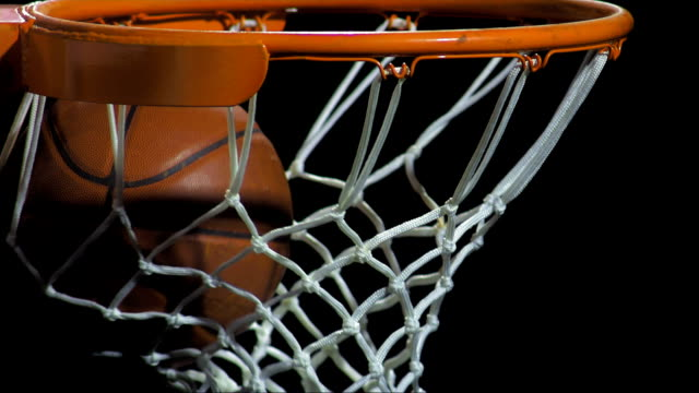scoring a basket (super slow motion) - basketball ball stock videos & royalty-free footage