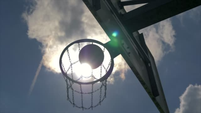 Scoring in basketball hoop on outdoor sport field