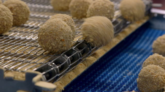 "scotch eggs on production line before and after frying - ""bbc universal"" stock videos & royalty-free footage"