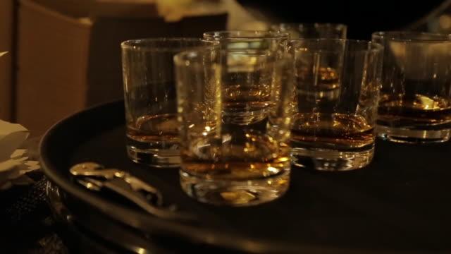 scotch glasses on serving tray - ボトルオープナー点の映像素材/bロール