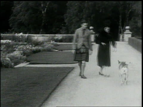 scotland balmoral castle princess marina visits prince george during their engagement / they walk in formal gardens play with german shepherd for... - mid adult couple stock videos & royalty-free footage