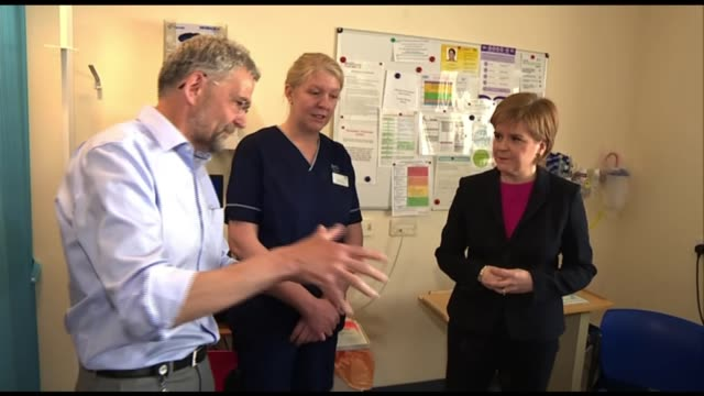 scotland becomes first country in world to impose minimum price for alcohol edinburgh int nicola sturgeon msp visiting liver unit of hospital... - image manipulation stock videos and b-roll footage